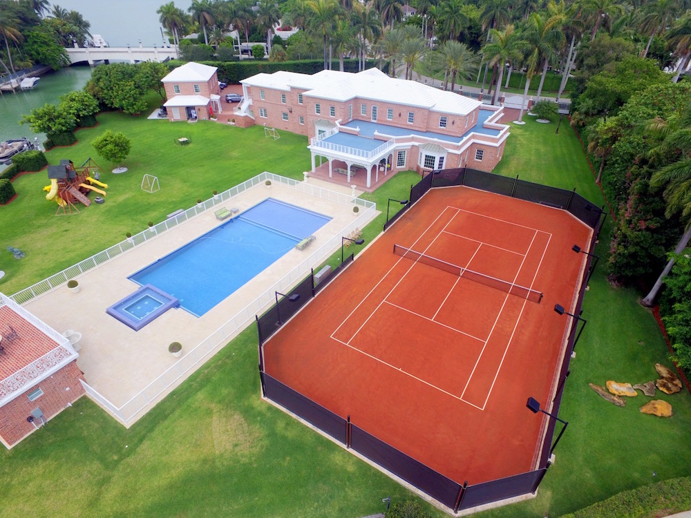 This $39 Million Home At 100 La Gorce Circle Boasts One Of The Best Tennis Courts In The U.S.